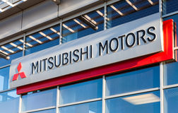 The emblem Mitsubishi on the office of official dealer. Royalty Free Stock Photo