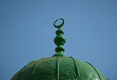 Emblem of Muslim. The emblem of Muslim on top of a green dome Stock Photography