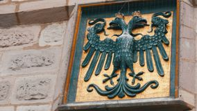 The emblem of Nuremberg, Germany on the wall in the historic part of the city. Black headed eagle stock footage