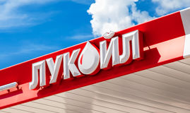 The emblem of the oil company Lukoil against the the blue sky Royalty Free Stock Image