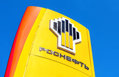 The emblem of the oil company Rosneft against the blue sky backg Royalty Free Stock Images