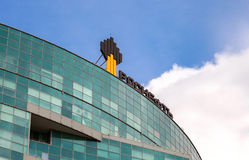 The emblem of the oil company Rosneft on the office building. Ro Royalty Free Stock Photo