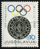 Emblem of the Olympic Games. RUSSIA KALININGRAD, 12 NOVEMBER 2016: stamp printed by Yugoslavia, shows the emblem of Olympic Commettee, circa 1968 Stock Photos