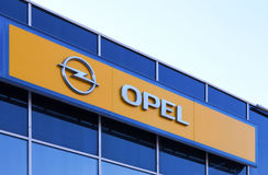 The emblem of Opel over blue sky. SAMARA, RUSSIA - APRIL 19, 2014: The emblem of Opel over blue sky. Opel is a German automobile manufacturer headquartered in royalty free stock photo