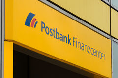 The emblem of Postbank. BERLIN - JULY 24: The emblem of Postbank. Postbank - Deutsche Postbank AG is a German retail bank, with revenues of 3.805 Mrd. Euro and Royalty Free Stock Photography