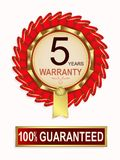 Emblem of red color with text of five-year warranty. Emblem of red color with gilding, ribbons and text five-year guarantee Stock Photography