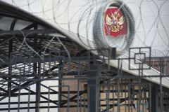 Emblem of Russia on the building of the Russian embassy in Kyiv. Emblem of Russia against the backdrop of barbed wire on the building of the Russian embassy in Stock Images