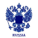 Emblem of Russia with blue pattern in national style Gzhel with inscription. Royalty Free Stock Images