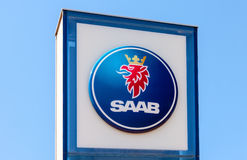 The emblem SAAB over blue sky. SAMARA, RUSSIA - MAY 24, 2014: The emblem SAAB over blue sky. Saab Automobile AB is a Swedish premium car manufacturer Royalty Free Stock Photo