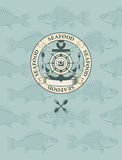 Emblem with the sailboat, wheel and anchor Royalty Free Stock Image