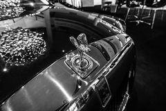 The emblem `Spirit of Ecstasy` of a full-size luxury car Rolls-Royce Phantom VII Series II Extended Wheelbase. BERLIN - DECEMBER 21, 2017: Showroom. The emblem Royalty Free Stock Photography
