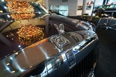 The emblem `Spirit of Ecstasy` of a full-size luxury car Rolls-Royce Phantom VII Series II Extended Wheelbase. BERLIN - DECEMBER 21, 2017: Showroom. The emblem Royalty Free Stock Images