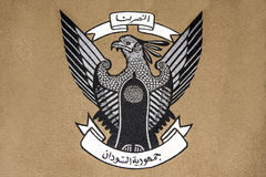 Emblem of Sudan. Embroidery of Sudan coat of arms on gray fabric with vector format file available Stock Photo