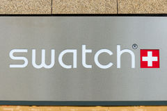 Emblem Swatch. Swatch Group Ltd. BERLIN - JULY 24: Emblem Swatch. Swatch Group Ltd. designs, manufactures, distributes and sells finished watches, watch Royalty Free Stock Photo