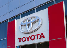 The emblem Toyota on the office of official dealer Stock Images
