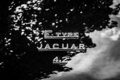 The emblem on the trunk of the sports car Jaguar E-Type 4.2. Royalty Free Stock Photo