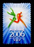 Emblema con due uomini correnti, serie dei giochi di commonwealth, circa 2006 Fotografia Stock