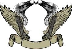 Emblema con las alas y el grifo, gráfico de la mano. Imágenes de archivo libres de regalías