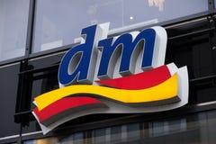 Emblema da loja do drogeriemarkt do Dm Fotografia de Stock Royalty Free