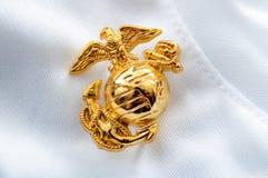 Emblema del Cuerpo del Marines de los E.E.U.U. en blanco imágenes de archivo libres de regalías