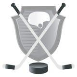 Emblema del hockey con el blindaje. Fotos de archivo