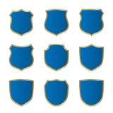 Emblema di forma messo icone blu dell'oro dello schermo Immagine Stock