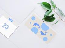 Emblema di giorno del delfino della balena del mondo 23 luglio Fotografie Stock