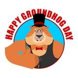 Emblema do dia de Groundhog Groundhog nos polegares do chapéu levanta e piscadelas Madeira Fotografia de Stock