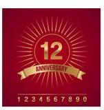 Emblema do ouro do aniversário/ícone com raios e toda numérico Imagem de Stock Royalty Free