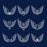 Emblemas cons alas Imágenes de archivo libres de regalías