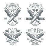 Emblemas de la bujía del servicio del coche Foto de archivo