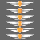 Emblemas del blindaje y de las alas Imagenes de archivo