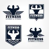 Emblemas del logotipo de la aptitud en diseño gráfico del estilo retro (alas y tono azul oscuro del músculo) Imágenes de archivo libres de regalías