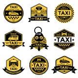 Emblemas do amarelo do preto do serviço do táxi Fotografia de Stock Royalty Free