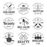 Emblemas do preto do vetor do salão de beleza do tratamento de mãos e do pedicure foto de stock