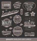 Emblemas y escrituras de la etiqueta de la calidad y garantizados Fotos de archivo libres de regalías