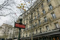 Emblematic metro sign in Paris stock photography