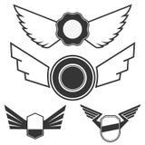 Embleme mit Flügeln Stockfoto