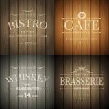 Emblemen op houten textuur Stock Afbeeldingen