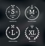 Emblemi di dimensione di usura Immagini Stock