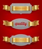 Emblemi di qualità con i nastri dorati Immagini Stock