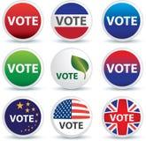 emblemknappar röstar Arkivbild