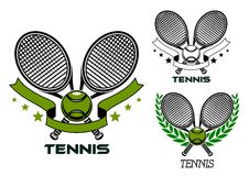 Emblems of crossed tennis rackets with balls Stock Photo