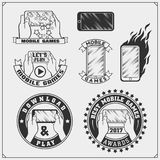 Emblems and icons of mobile games and apps. Vector Stock Images