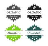 Emblems of Organic Tasty food Stock Photos