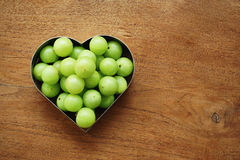 Emblica, amla grüne Früchte Stockfoto