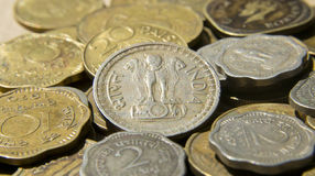 Emblème national sur les pièces de monnaie indiennes Photo libre de droits