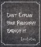 Embody it Epictetus. Don`t explain your philosophy. Embody it - ancient Greek philosopher Epictetus quote written on framed chalkboard stock photo