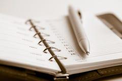 Embolse el planificador y la pluma Fotos de archivo libres de regalías