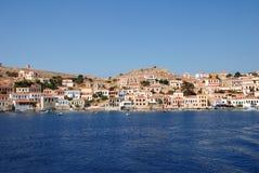 Emborio harbour, Halki island. View from the sea of Emboria harbour on the Greek island of Halki, on June 12, 2010 Stock Photos